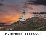 Anacapa island lighthouse with nesting seagulls and sunset sky at Channel Islands National Park in Ventura County California.