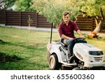 smiling man riding a lawnmower... | Shutterstock . vector #655600360