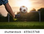 soccer player kicking a ball in ... | Shutterstock . vector #655615768