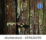 An Old Fade Wooden Door In A...