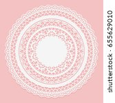 white lace napkin on a pink...   Shutterstock . vector #655629010