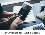 person touching tablet with... | Shutterstock . vector #655665898
