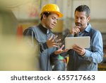boss and worker checking... | Shutterstock . vector #655717663