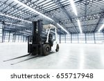 forklift in a warehouse | Shutterstock . vector #655717948