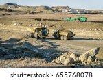 large dump trucks on a road... | Shutterstock . vector #655768078