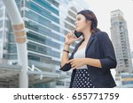 business woman using smartphone | Shutterstock . vector #655771759