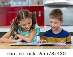 smiling siblings looking at... | Shutterstock . vector #655785430