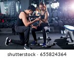 young adult woman working out... | Shutterstock . vector #655824364