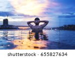 a man relax in the water under... | Shutterstock . vector #655827634