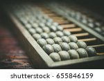abacus on the brown wooden... | Shutterstock . vector #655846159