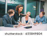 businesswoman and team... | Shutterstock . vector #655849804