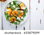 fresh salad with grilled peach... | Shutterstock . vector #655879099