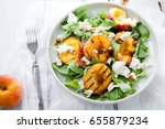 fresh salad with grilled peach... | Shutterstock . vector #655879234