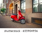 red vintage scooter parked on a ... | Shutterstock . vector #655904956