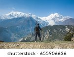 man stand on the cliff in nepal | Shutterstock . vector #655906636