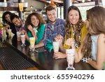 happy friends having drink in... | Shutterstock . vector #655940296