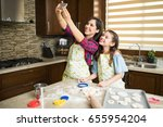 pretty single mother and her... | Shutterstock . vector #655954204