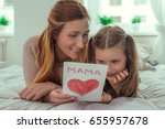 girl surprising parents with...   Shutterstock . vector #655957678