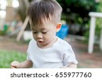 asian baby boy look somewhere... | Shutterstock . vector #655977760