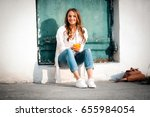 smiling beautiful woman holding ... | Shutterstock . vector #655984054