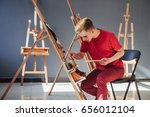 artist painting a picture in a...   Shutterstock . vector #656012104