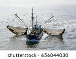 fishing boat dragging a net... | Shutterstock . vector #656044030