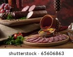 A composition of different sorts of sausages on the table - stock photo