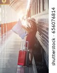 woman with suitcase waiting for ... | Shutterstock . vector #656076814