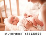 cute baby girl lying on mothers ... | Shutterstock . vector #656130598