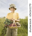 Small photo of Boy with a scuttle of Beetroots