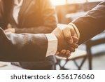 business people shaking hands | Shutterstock . vector #656176060