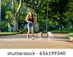 girl riding with dogs on a... | Shutterstock . vector #656199340