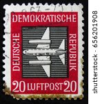 "Small photo of MOSCOW, RUSSIA - APRIL 2, 2017: A post stamp printed in DDR (Germany) from the ""Airmail "" issue shows Aircraft, circa 1957"