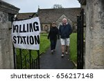 Small photo of Bradford on Avon, UK - June 8, 2017: Voters leave a polling station at a village church. Polling stations have opened across the nation as voters decide UK's government in a general election.