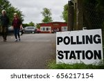 Small photo of Melksham, UK - June 8, 2017: Voters leave a polling station at a village hall. Polling stations have opened across the nation as voters decide UK's government in a general election.