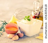 Small photo of Garlic sauce Aioli on the gray stone background. Copy space. Selective focus
