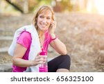 young fit adult woman outdoors...   Shutterstock . vector #656325100