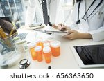 a doctor pointing to the... | Shutterstock . vector #656363650