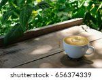 cup of coffee latte with... | Shutterstock . vector #656374339