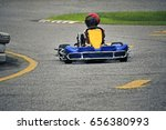 kid drive go kart in racetrack. | Shutterstock . vector #656380993