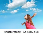 Small photo of Little girl outstretched arms and closed her eyes enjoying and breath fresh air.