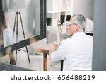 senior businessman near opened... | Shutterstock . vector #656488219