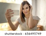 beautiful brunette take selfie... | Shutterstock . vector #656495749