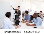 woman pointing at whiteboard at ... | Shutterstock . vector #656504410
