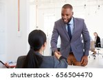 Black Businessman And Seated...