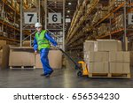 warehouse worker dragging a... | Shutterstock . vector #656534230