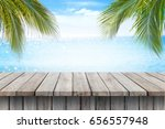 empty wooden table and palm... | Shutterstock . vector #656557948