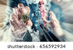 Small photo of Businessman holding Bitcoin. Bitcoin at All-Time High investment (new virtual money)