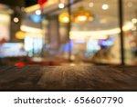 empty wooden table in front of... | Shutterstock . vector #656607790
