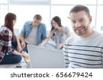 delighted positive man smiling | Shutterstock . vector #656679424